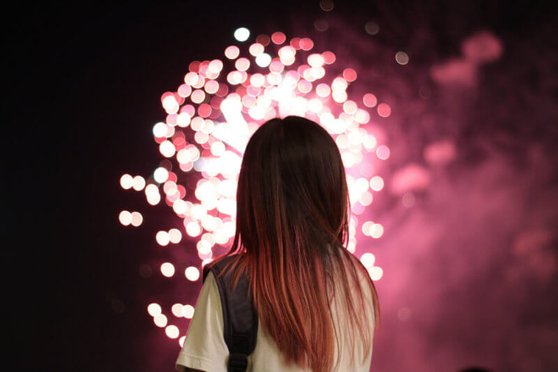 Girl looking at fireworks - Facebook changes